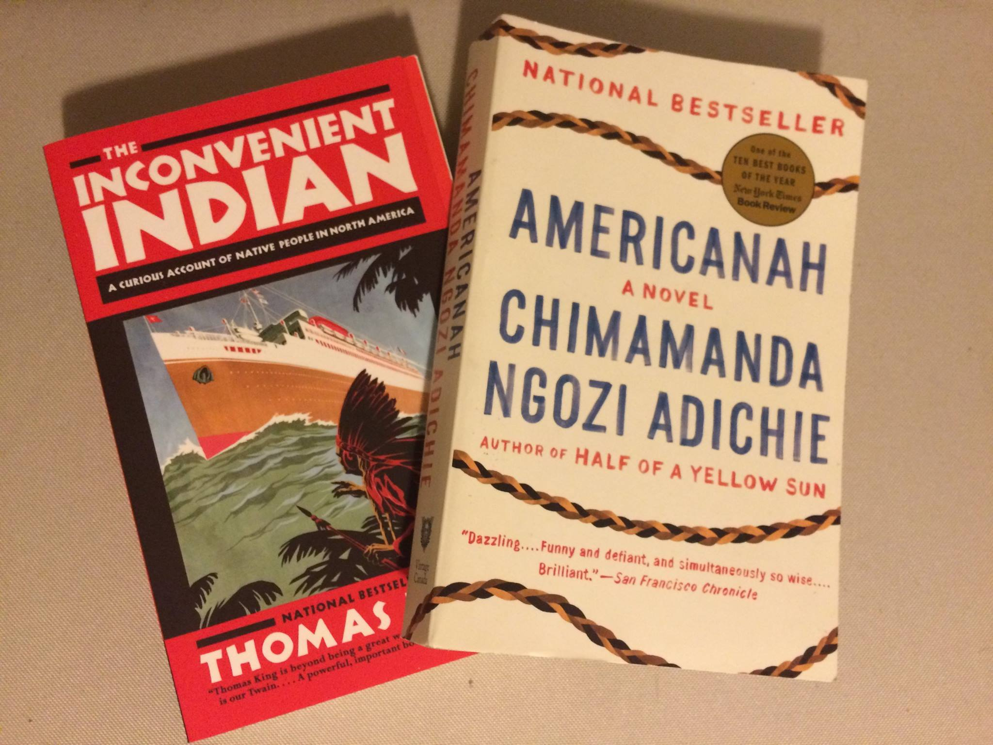 Photo of two book covers: Americanah and The Inconvenient Indian