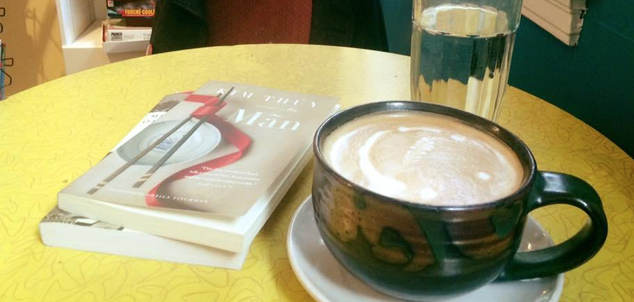 Photo of Man by Kim Thuy being read in a coffee shop