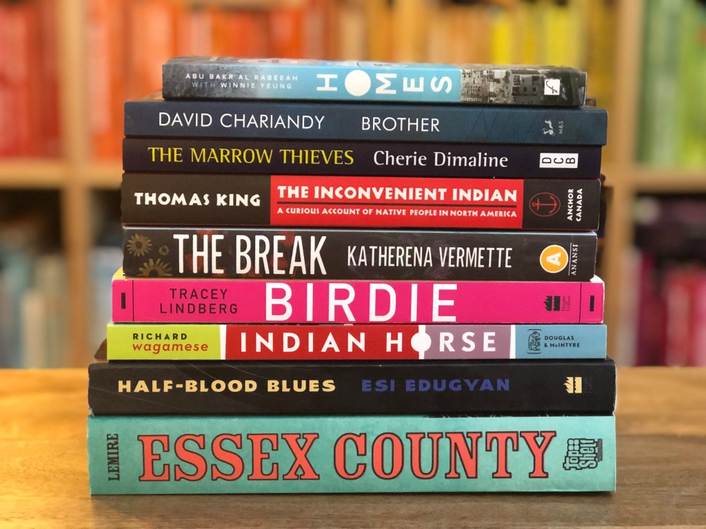 A photo of all 9 CANADA READS FINALISTS THAT DIDN'T WIN BUT ARE WELL WORTH THE READ in one stack